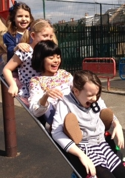 Young carers on slide
